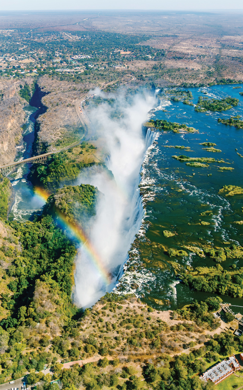 Left: Helicopter view of Victoria Falls, the largest curtain of water in the world.  Vadim Petrakov / Shutterstock.com
