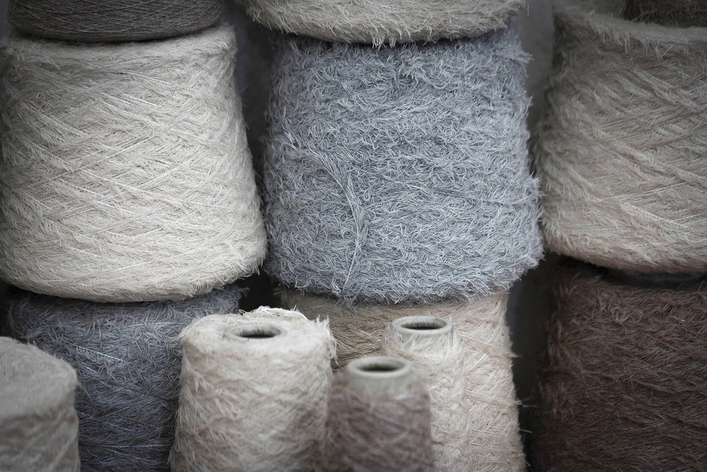 One of the rarest natural fibers in the world, soft cashmere wool is combed from the necks of Hircus goats in Mongolia and spun into spools of luxurious thread.