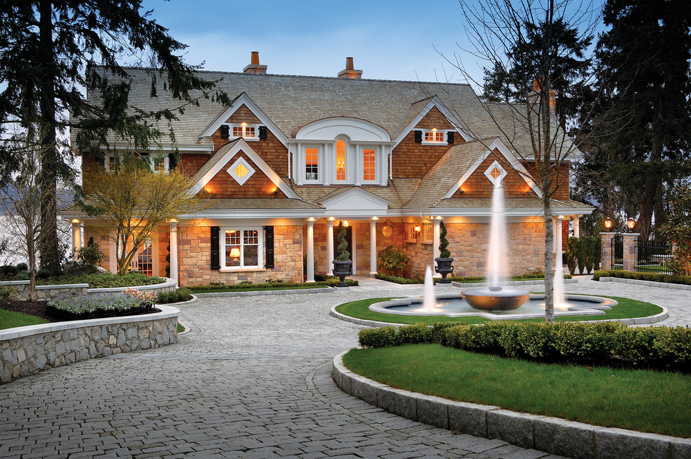 On the shores of Saanich Inlet, this magnificent Shingle-style residence has a graceful, organic feel with its gabled roof, Palladian windows and rounded contours.