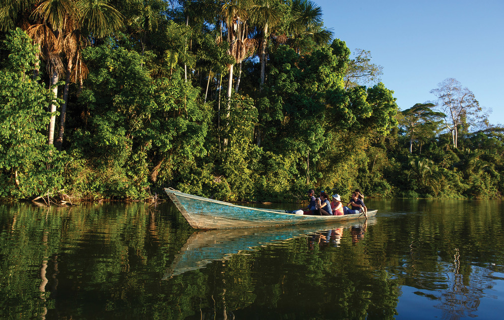 Small boats like these are the taxis of the Amazon, taking people from village to village. These skiffs can get you closer to the indigenous flora and fauna. Christian Vinces / Shutterstock.com