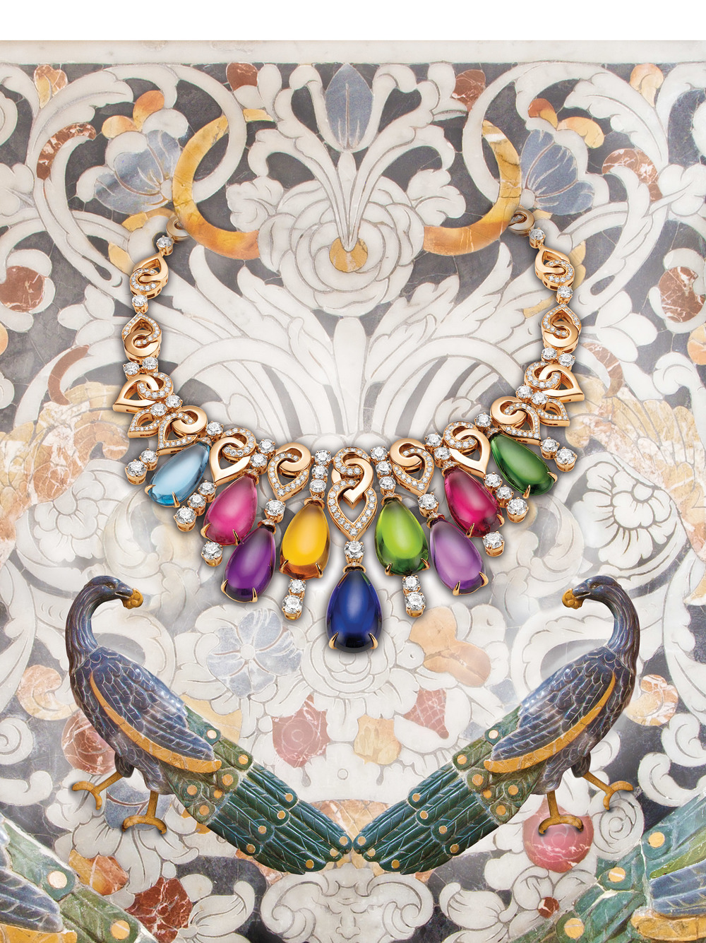 Bulgari High Jewellery Necklace  In a vivid burst, an explosion of colour paints the world with the freshness of art born anew. 18K pink gold necklace with 1 tanzanite, 2 amethysts, 1 peridot, 1 rubellite, 1 tourmaline, 1 pink tourmaline, 1 citrine quartz, 1 aquamarine, 49 round brilliant-cut diamonds and pavé diamonds.  Price upon request,1.800.BVLGARI   Bulgari.com