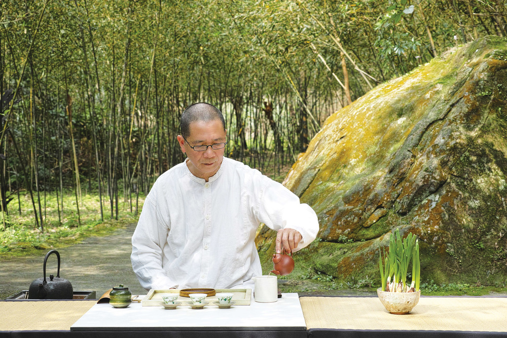 Lin Pin-Hui prepares High Mountain tea at his culinary mountainside retreat known as Shi-Yang Culture Restaurant. Inhaling the fragrance is as sweet as a lush flower garden.