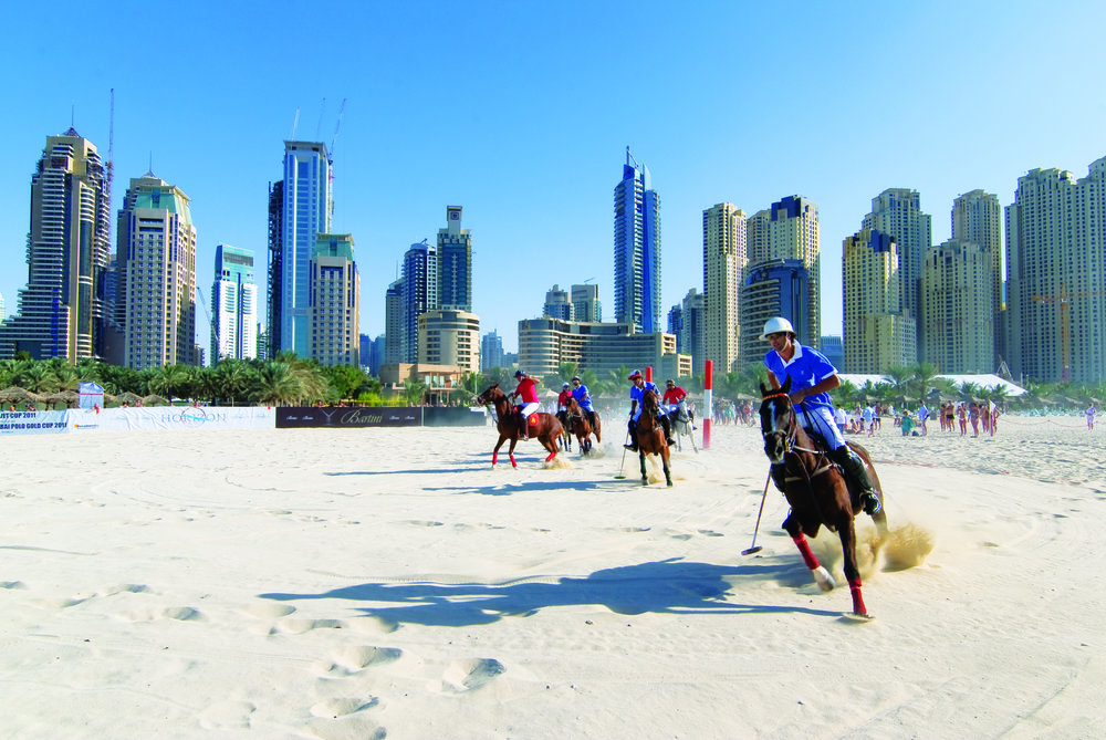 The city skyline has grown up around the Dubai Beach Polo Tournament as it celebrates its 12th year in 2016. Dubai: esherez / Shutterstock.com