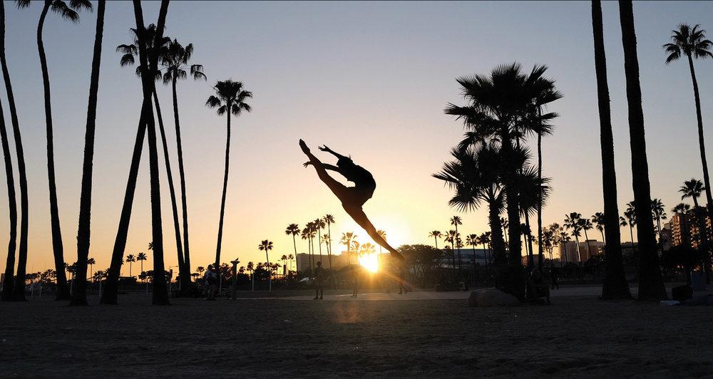 Shen Yun principal dancer Angelia Wang soars outside Long Beach's Terrace Theatre.Photography by Nancy Wang, www.shenyun.com