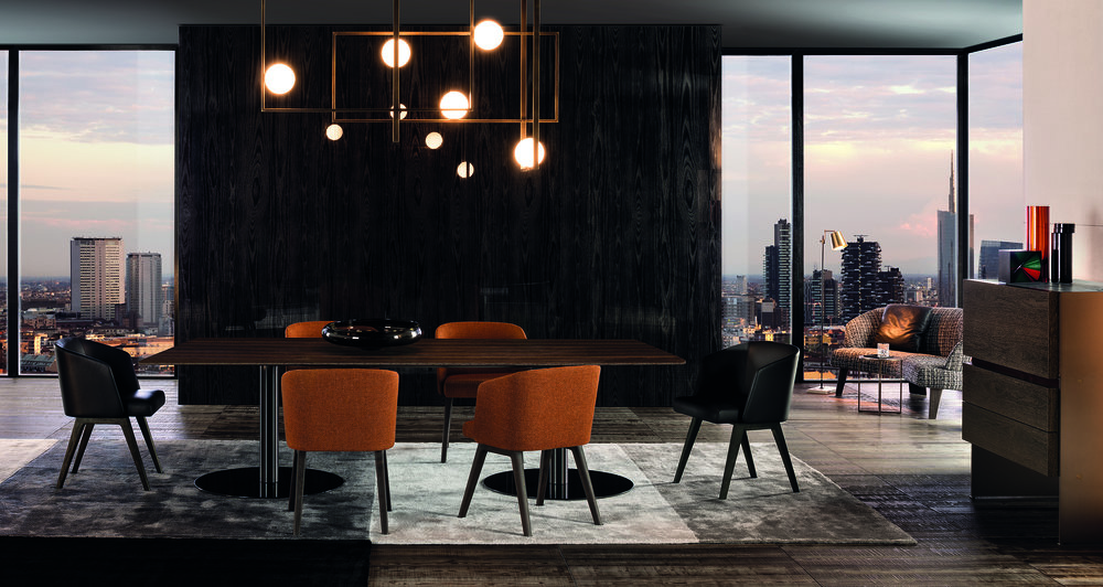 Minotti captures its classic aesthetic and understated elegance in its 2016 Bellagio dining table and Creed chairs. www.minotti.com