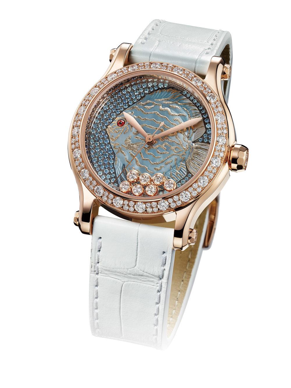 "Chopard  Happy Fish ""Métiers d'Arts"" 36mm Automatic Watch Ref. 274891-5015, $66,430  自蕭邦2002年推出Happy Fish系列以來,錶盤上歡樂躍動的波濤和五彩斑斕的魚兒便吸引了眾人的目光。如今,一條由珍珠貝母和金葉雕琢成的雍容優雅的魚兒再次躍然而出,獨特的夜光設計,令魚兒在夜晚愈加栩栩如生。錶盤上七顆自由活動的鑽石,如海底浮動的氣泡,與魚身周圍雪花式鑲嵌的漸變藍寶石交相輝映。防水30米,限量25枚。  At Lugaro Jewellers, (604) 925-2043, chopard.com"