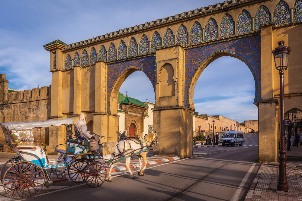 The Blue Gate of Fes welcomes visitors into the Medina with a beautiful mosaic. The reverse side shows a green mosaic, the colour of Islam, to the market. Maurizio De Mattei / Shutterstock.com