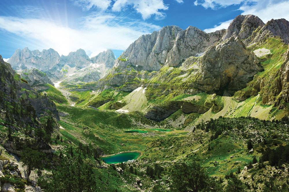 Montenegro is known for its pristine sandy beaches and imposing mountains.