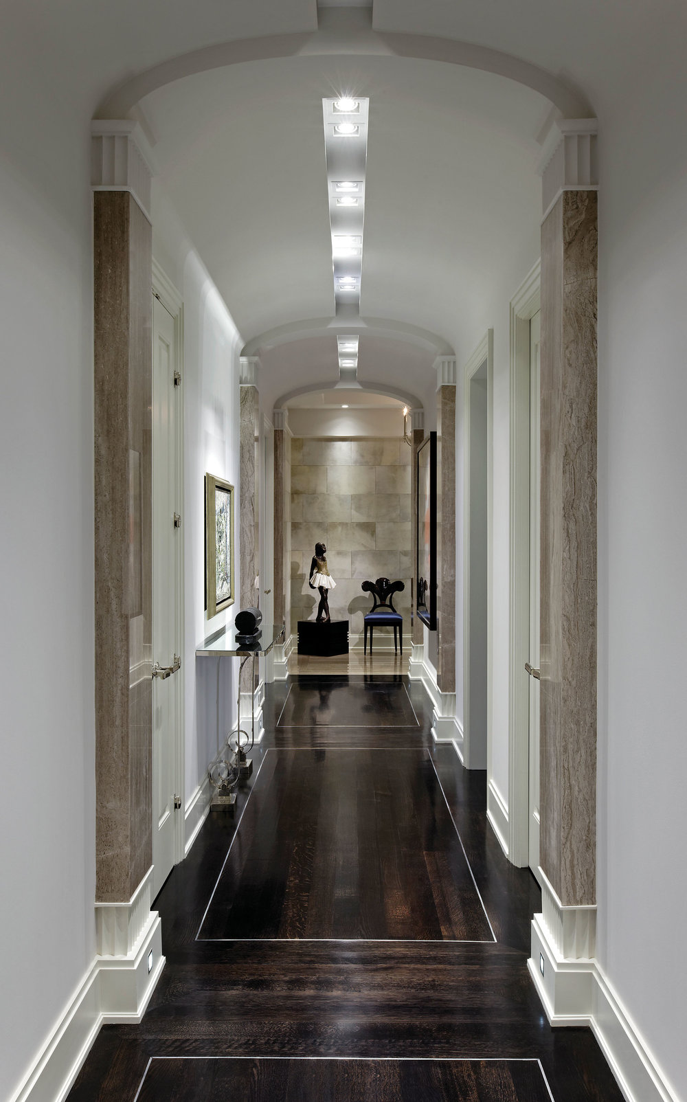 The entry hall features stone slab pilasters.