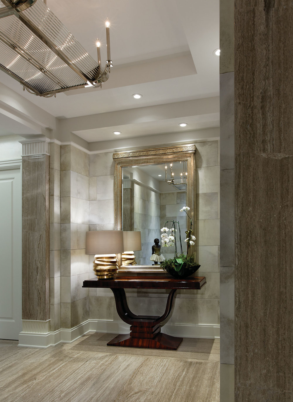 Goatskin covers the wall tiles of the apartment's foyer. Lush wallcoverings like these became popular in France in the 1920s, 30s, and 40s.