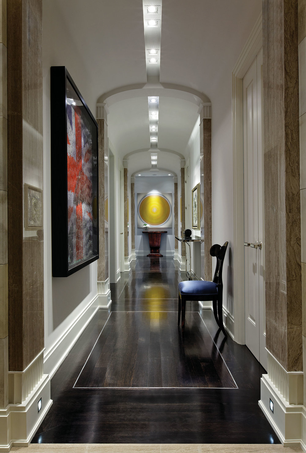 A recessed trough for lights and a simplified seamless oval barrel vault turn a classical colonnade into a modern gallery hall.