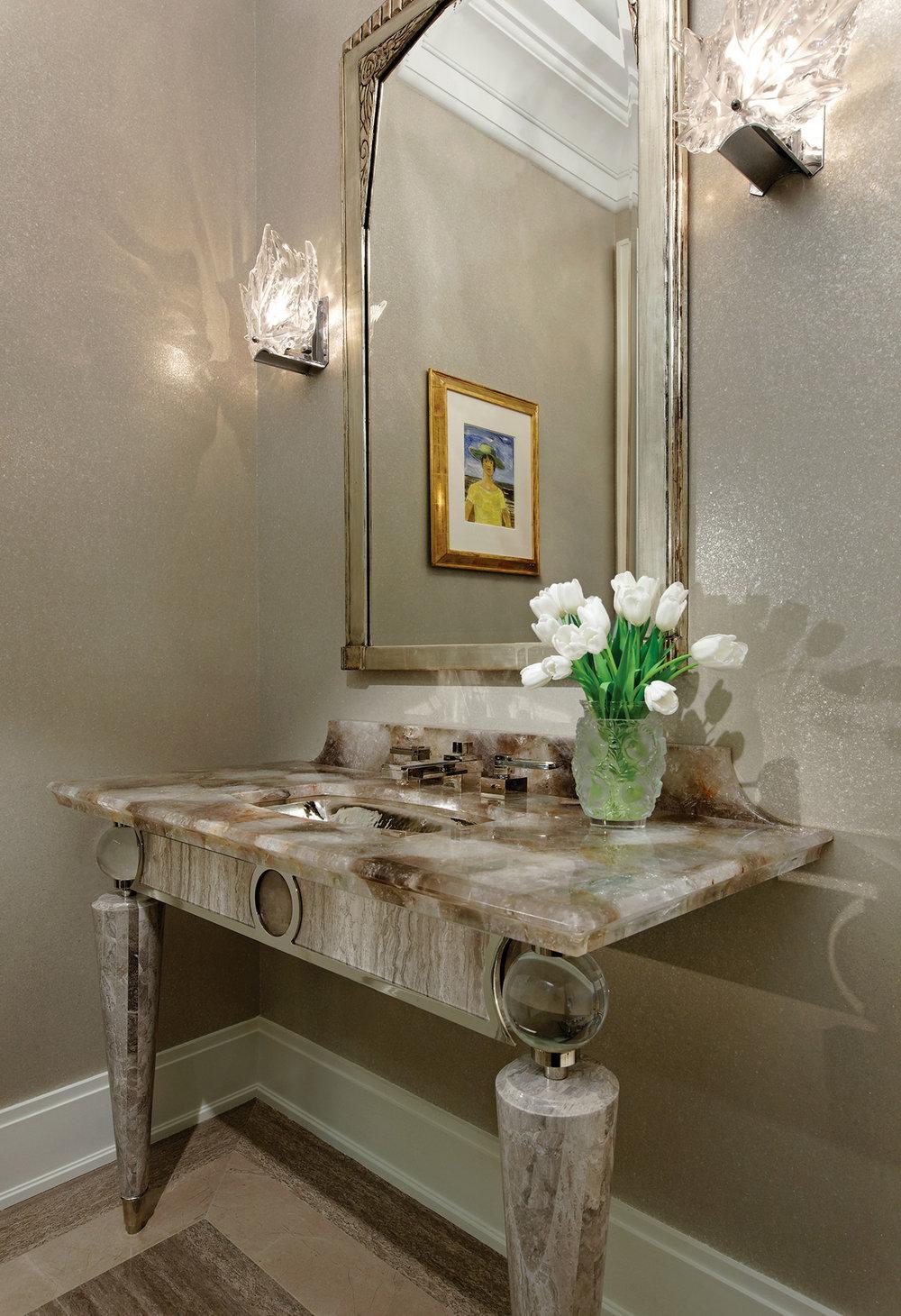 The semi-precious, semi-translucent quartz vanity that Douglas drew was a true challenge for the craftsmen, down to the custom shape of the edge's profile.