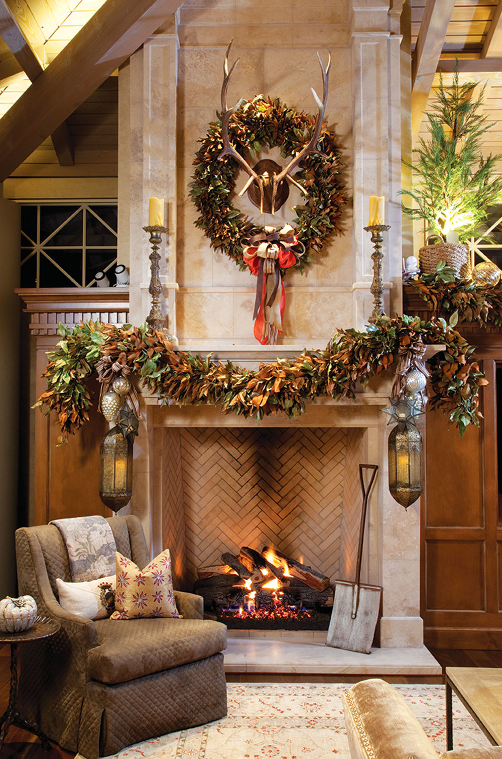 Designer Leanne Michael brought fresh cut Magnolia to create a rich Christmas experience for both eyes and nose. Found objects such as an antique snow shovel and burnished lanterns are a tasteful nod to Christmas tradition.