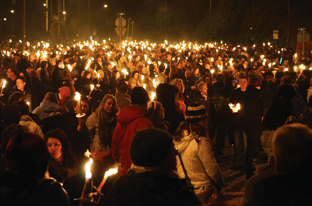 Over 40,000 people assemble to take part in and watch the annual torchlight procession that creates a river of fire through the city.