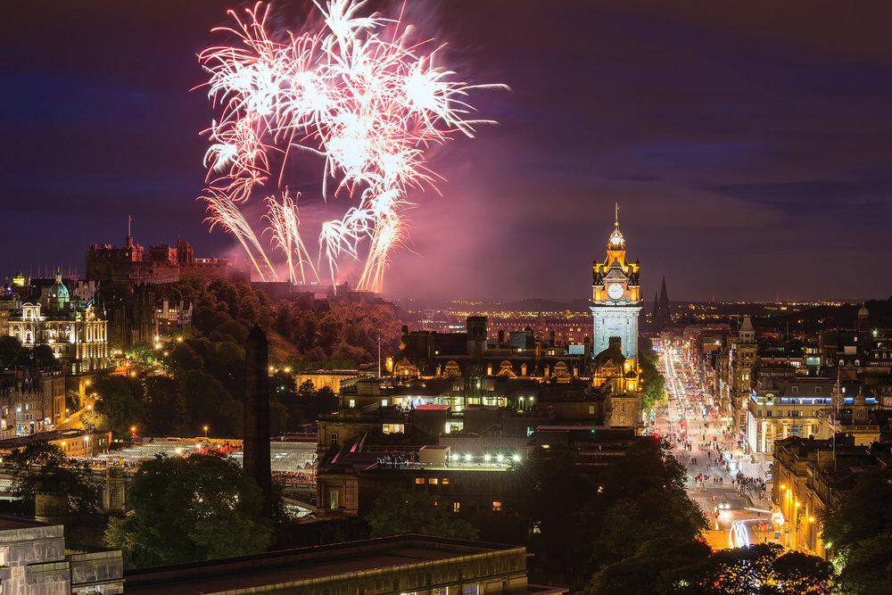Fireworks light up the sky above the Balmoral clock tower, which displays the correct time only on Hogmanay. Otherwise, it runs three minutes fast to encourage riders to make their trains at the neighbouring station.