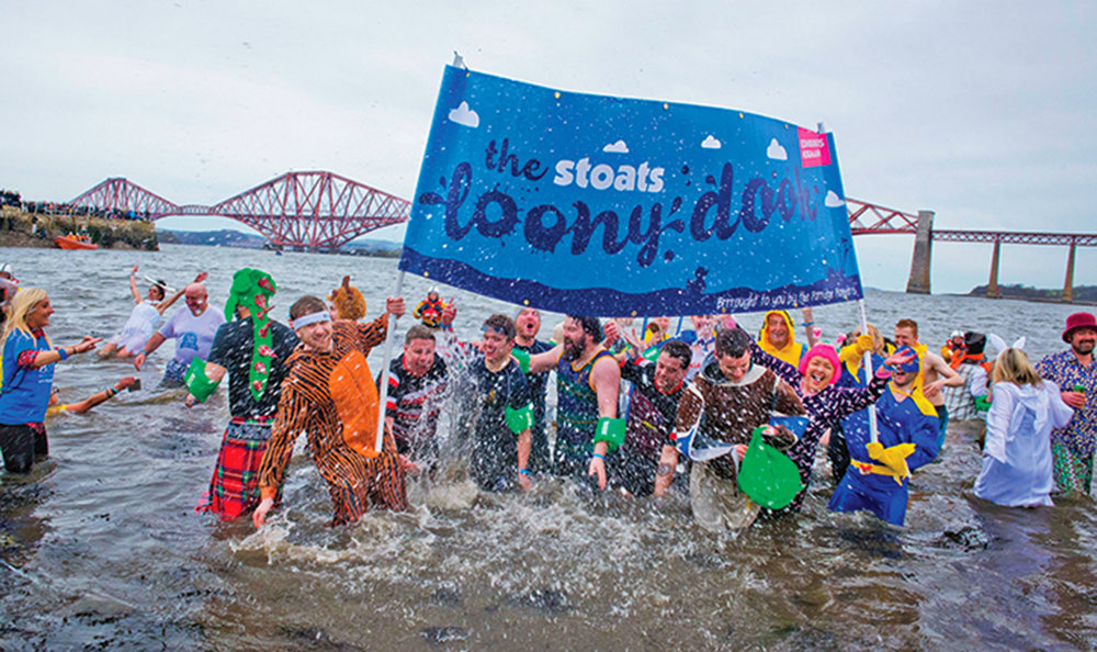 About 1,500 Dookers take part in the annual dip into the freezing Firth of Forth in what started as a hangover cure and has turned into a popular tradition.