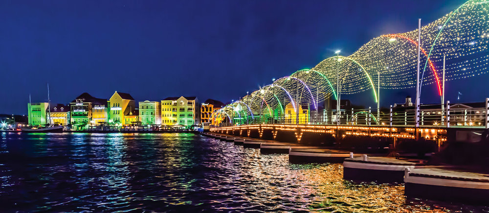 The festive Queen Emma Bridge leads into the Punda quarter of Willemstad, Curaçao.