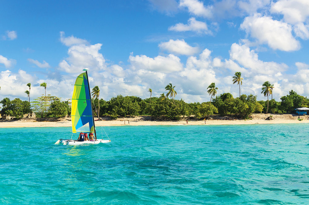 A catamaran is a perfect rental the whole family can enjoy as it's easier to learn to sail than a single hull craft.