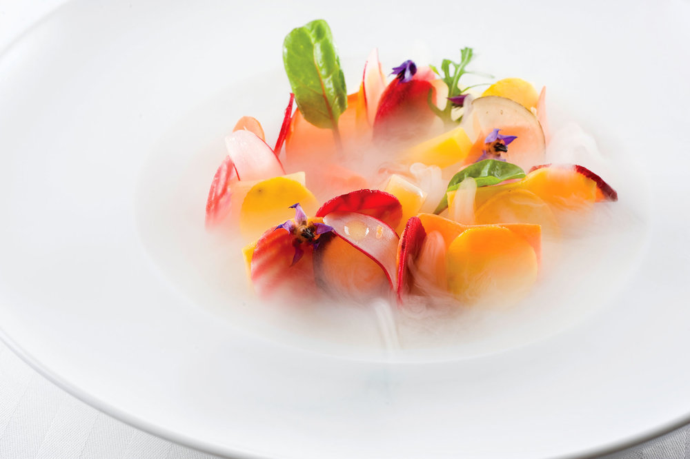 Assortment of cooked and raw autumn root vegetables with oyster vinaigrette.