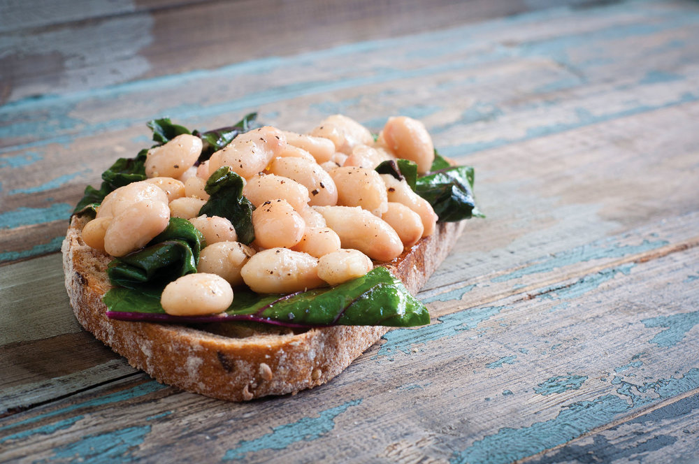 White cannellini beans are a traditional accompaniment to the thick bistecca, thanks to their silky texture and nutty taste. CatchaSnap / Shutterstock.com