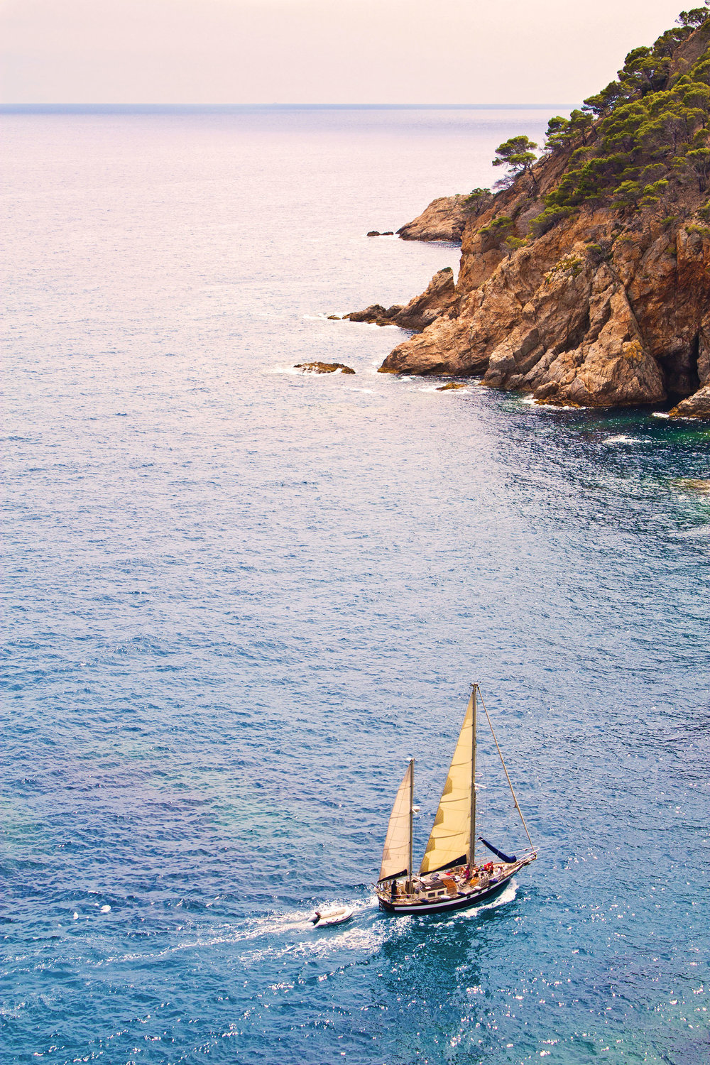 With miles of shoreline and a calm Mediterranean, sailing is the perfect adventure for any trip to Barcelona. Marques / Shutterstock.com