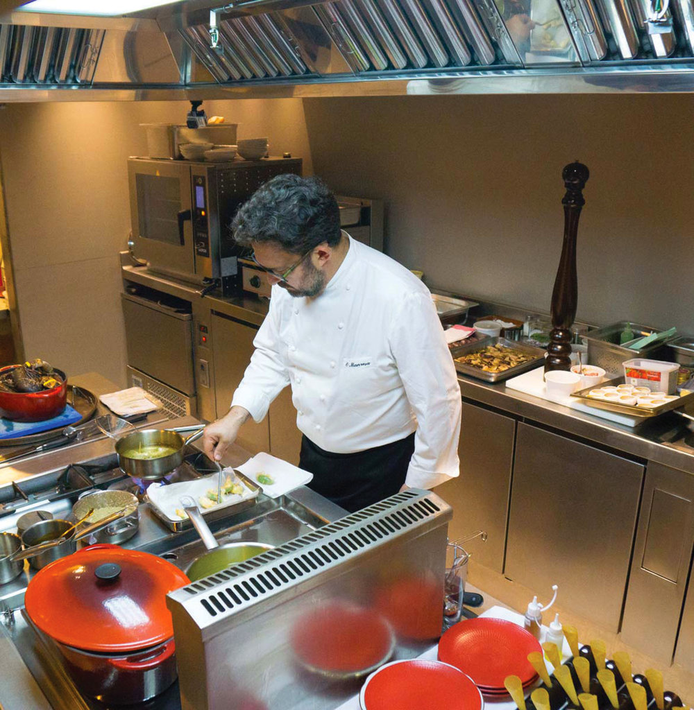 Oscar Manresa cooks in his private show kitchen, called El Altar. Photo courtesy of Oscar Manresa