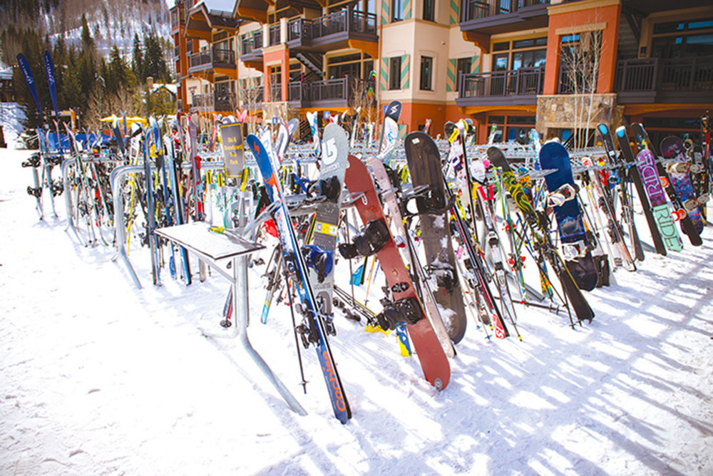 Skis line up on the racks while their owners take a break from the mountain. CHRISTIAN DE ARAUJO / shutterstock.com