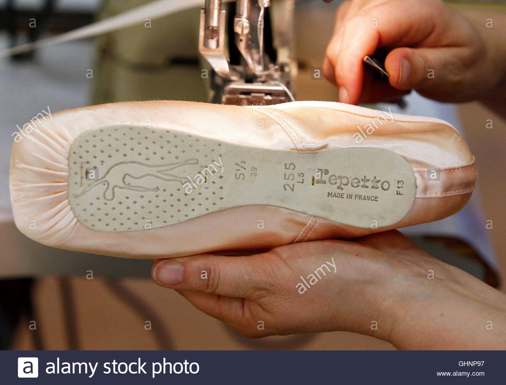 an employee works on a Repetto pointe shoe for ballet dancers