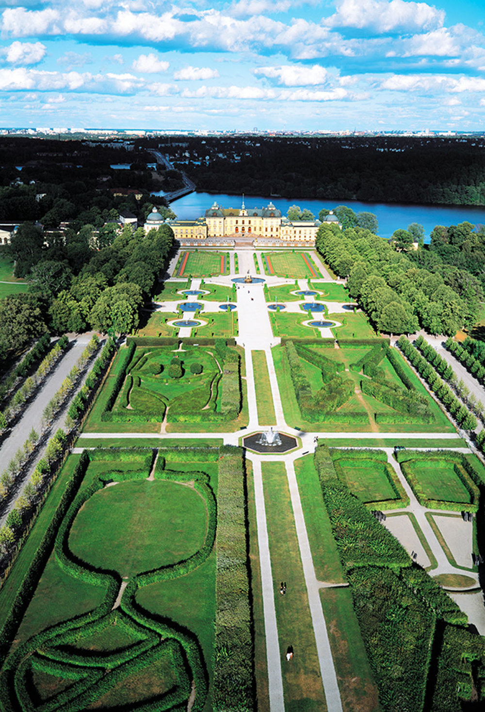 Walkways wind through the formal baroque and English-style gardens that surround the palace, which fronts Lake Mälaren.