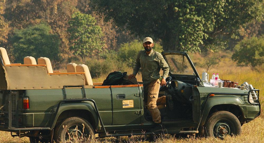 Naturalist Yajuvendra Upadhyaya steps from a Taj Safaris Jeep during an expedition at Panna National Park.Photo Courtesy of Taj Safaris