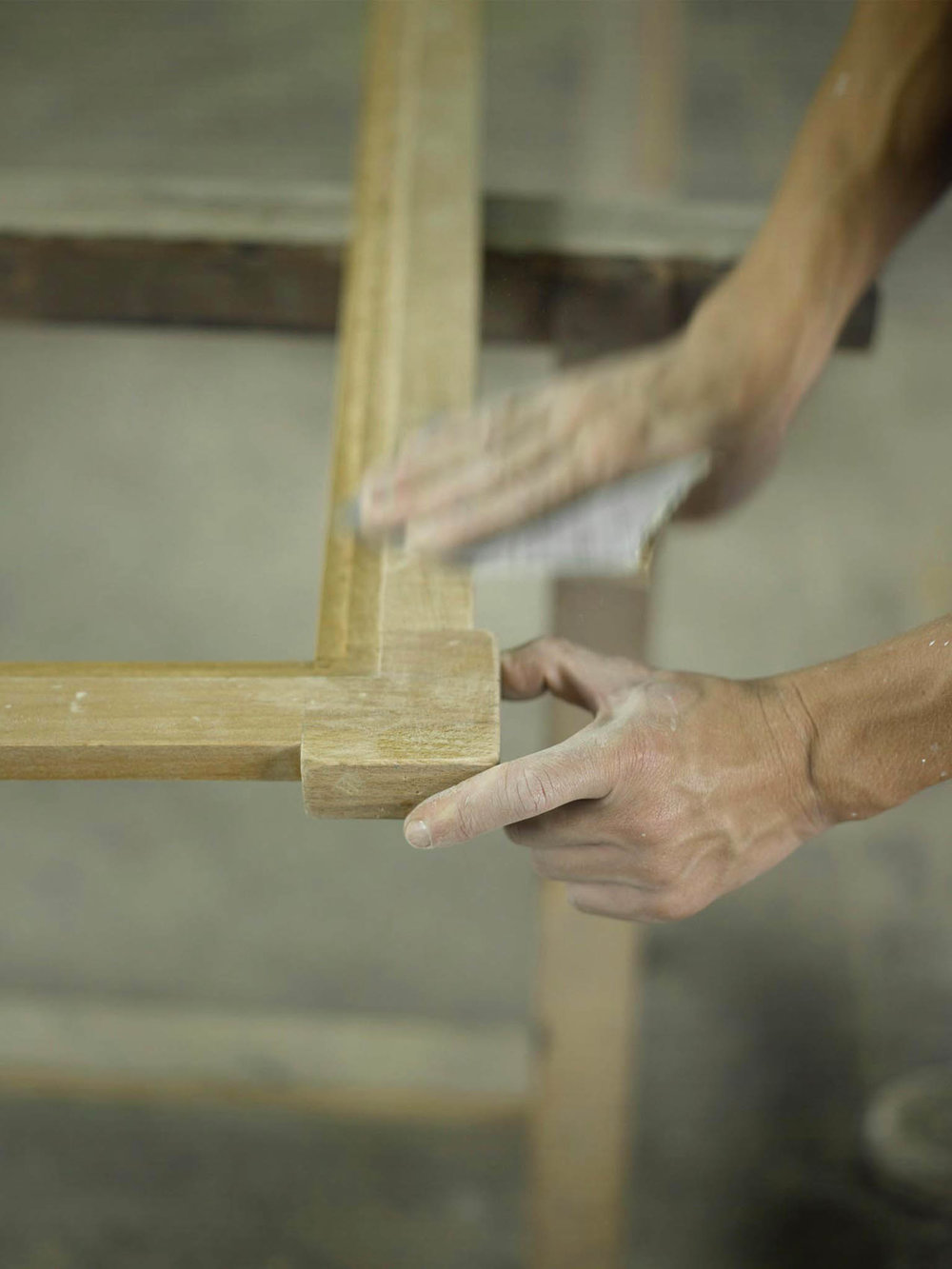 A craftsman sanding wood.Photos by Kim Bellavance