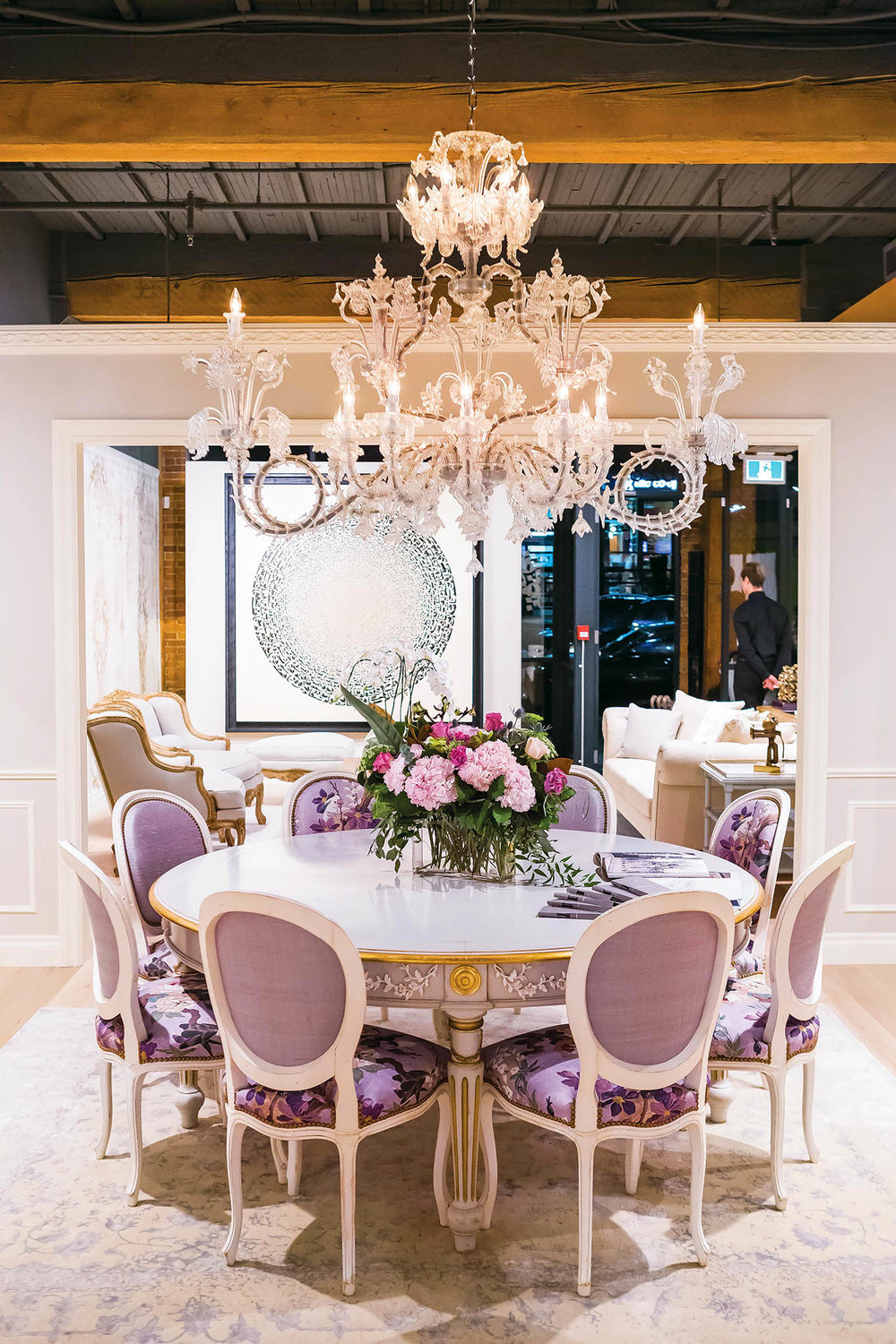 The Napoleon III dining table with fleurette decoration and Regency medallion chairs inside the Vancouver showroom. Photos by Kim Bellavance