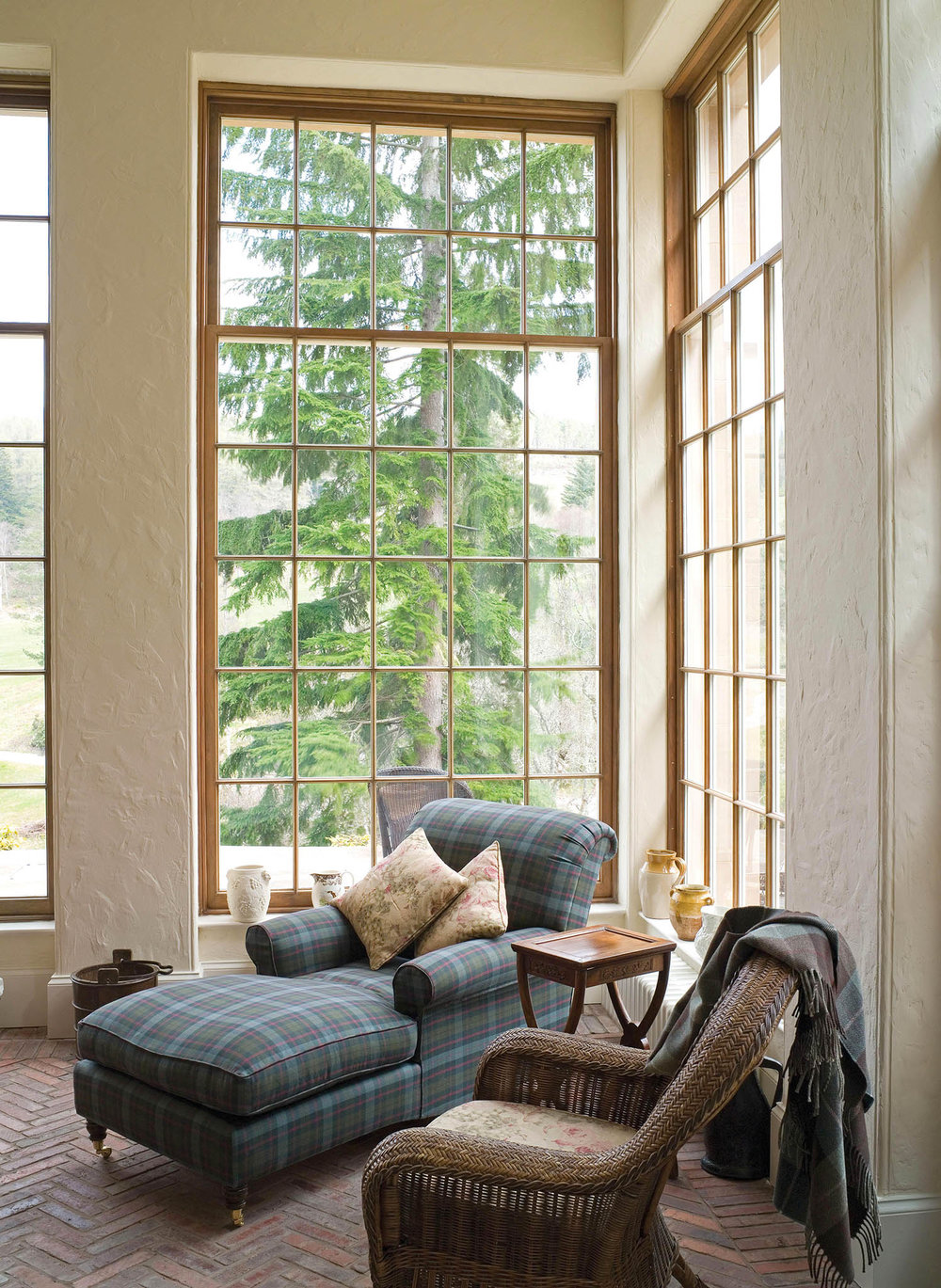 The family tartan gives a casual warmth to this secret garden room.