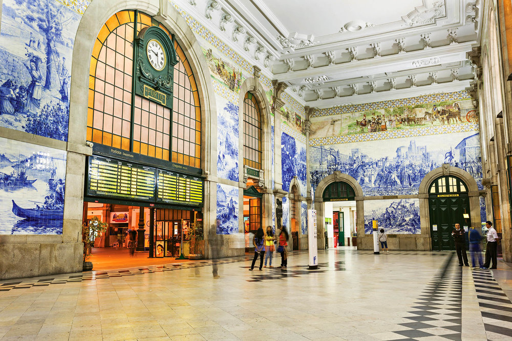 Tourists can learn the history of Portugal from the azulejos that bedeck the walls of the São Bento train station in Porto. saiko3p / shutterstock.com