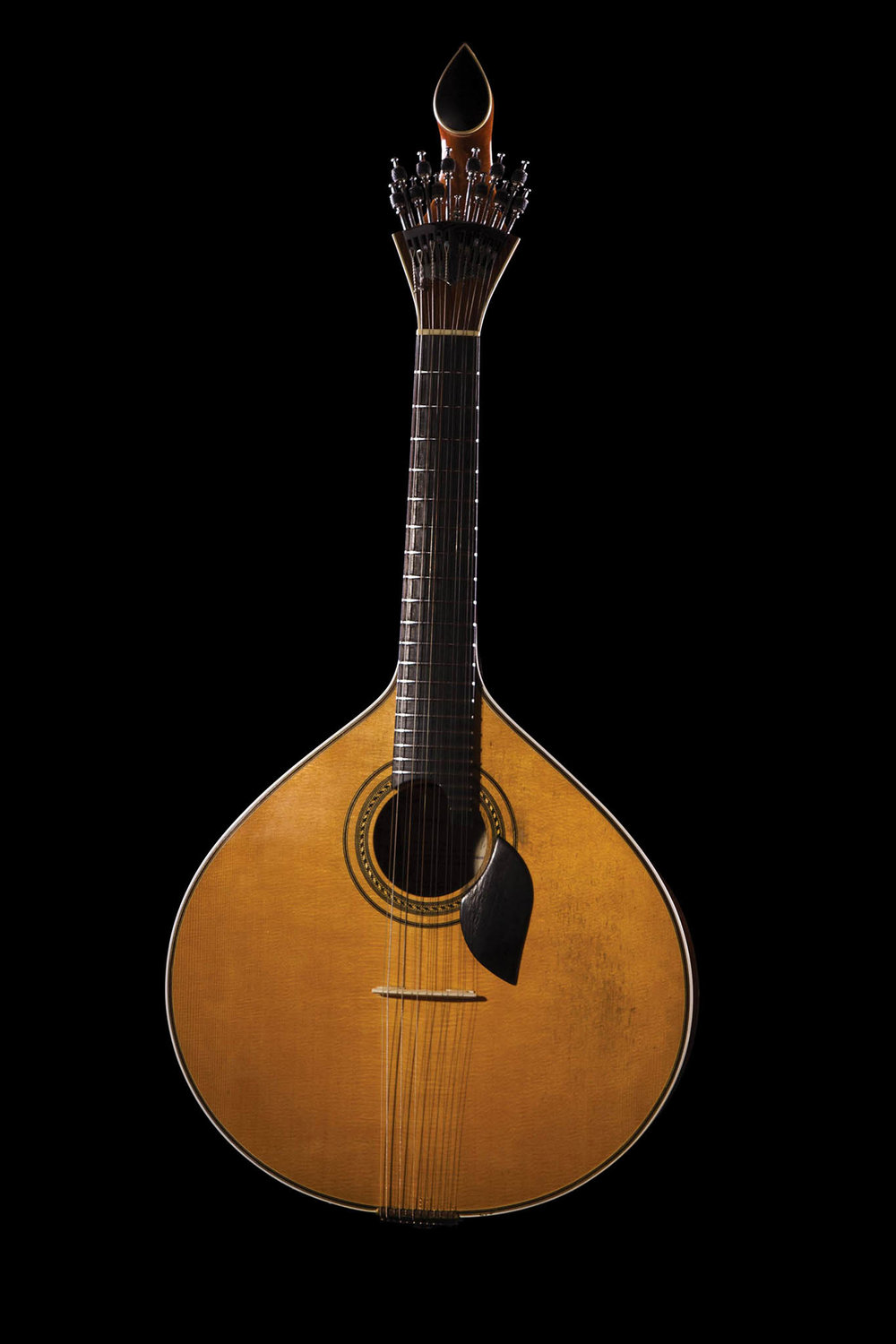 The Portuguese guitar can be identified by its pear-shaped harmonic box and tear shape at the end of the head.Mauro Rodrigues / shutterstock.com
