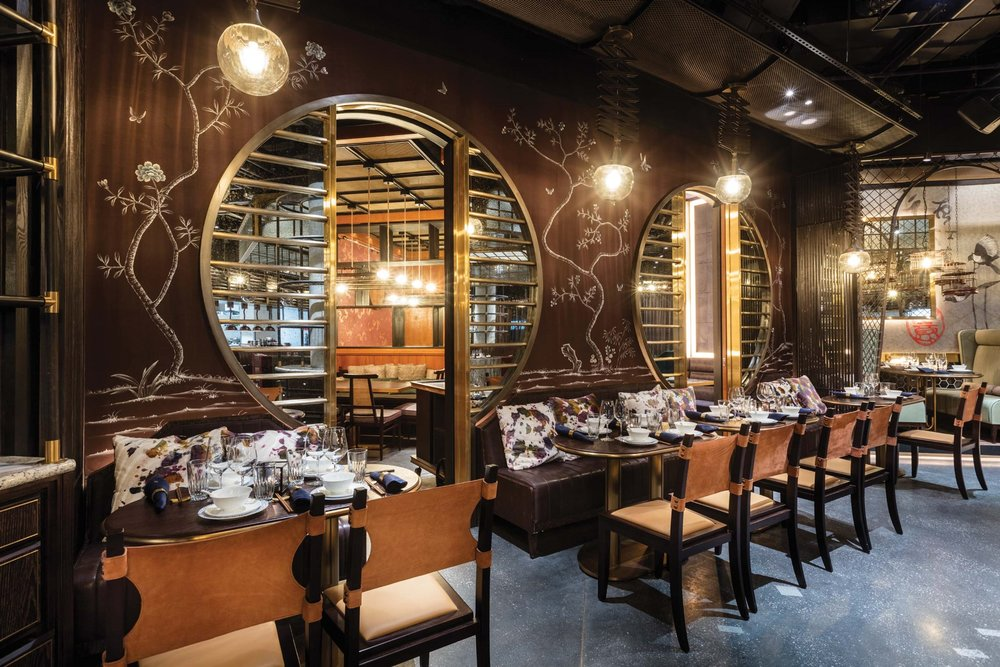 The Mott 32 dining room blends rich wood tones with traditional Asian motifs to create an oasis of tranquil elegance.
