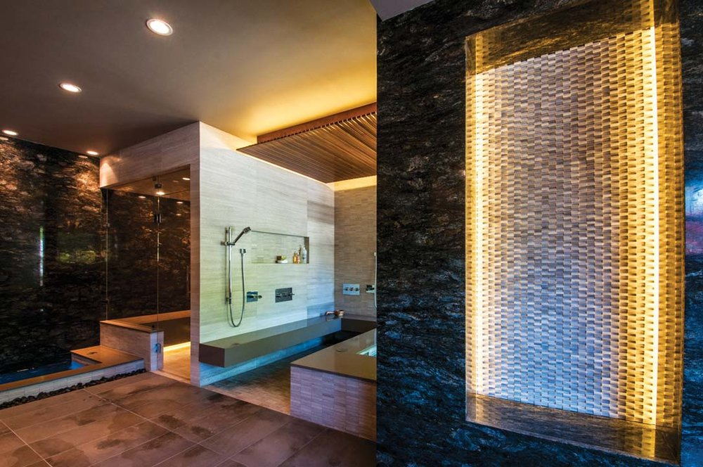 Luxurious spa with sauna, steam room, hot tub, and cold plunge pool. Accents include natural stone, limestone, granite and quartz. Fibre optic lights in sauna illuminate with starry-night-sky effect.