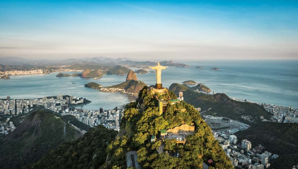 The statue of Christ the Redeemer perches atop Botafogo Bay. marchello74 / Shutterstock.com