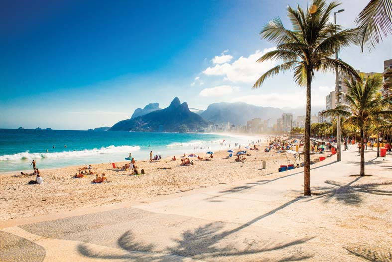 Sunbathers flock to Ipanema Beach, with its view of the Two Brothers Mountain. Aleksandar Todorovic / Shutterstock.