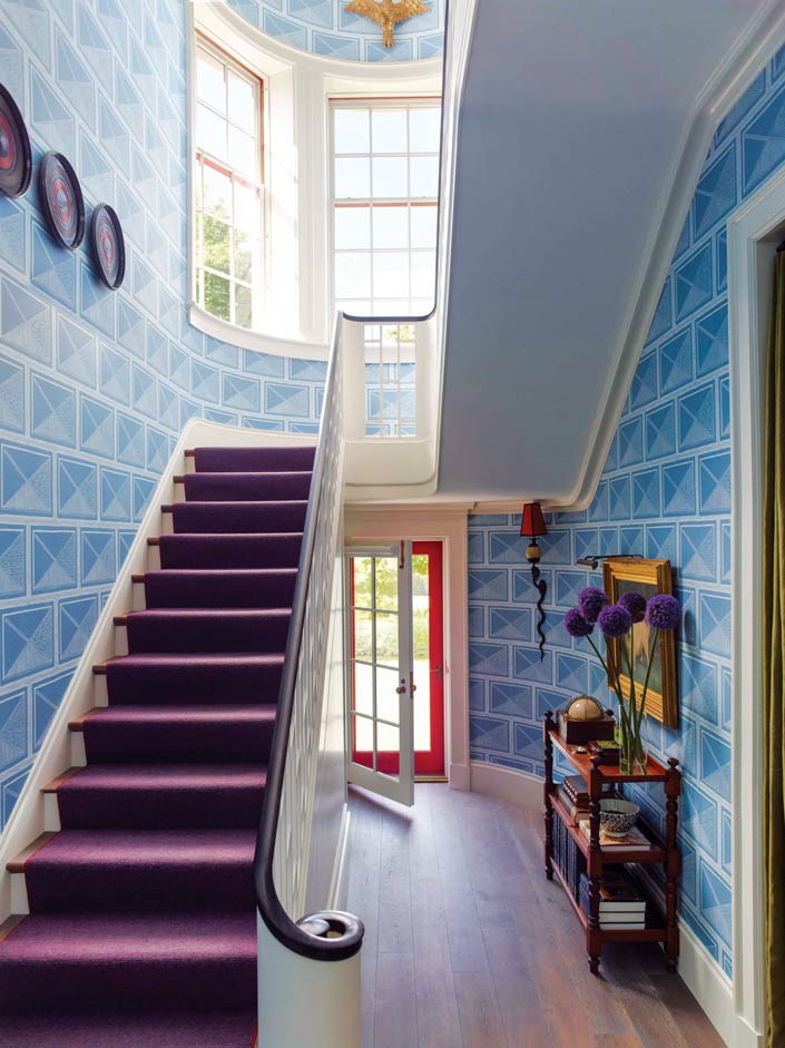 Beauty is in the details as red tape bounds the purple woolen stair runner, and 19th-century Japanese lacquerware trays adorn the wall.