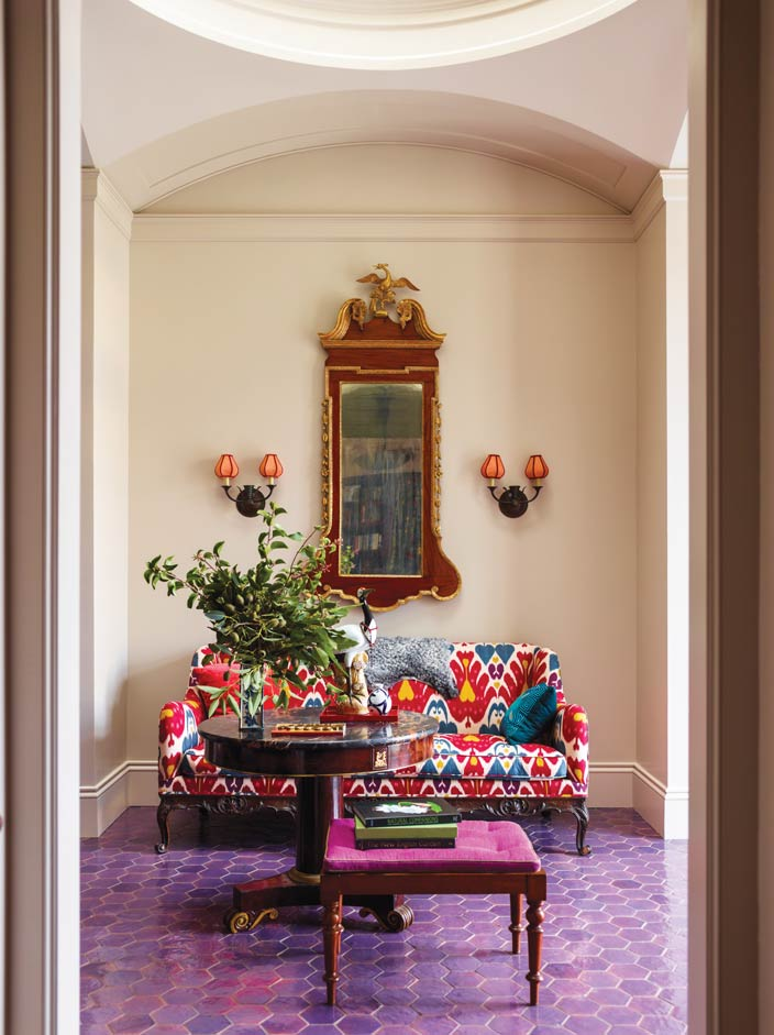 Treasures abound in the home, such as the 19th-century stained-mahogany sofa and 20th-century Swedish sconces.