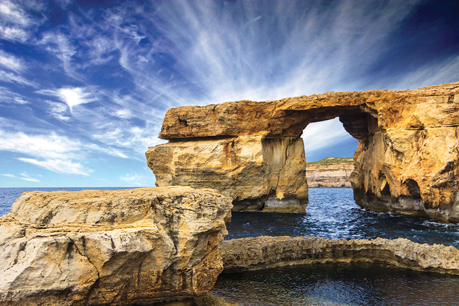 Malta's Azure Window, a massive flat-topped sea arch, was once the pride of the tiny archipelago nation.Krzyzak / Shutterstock.