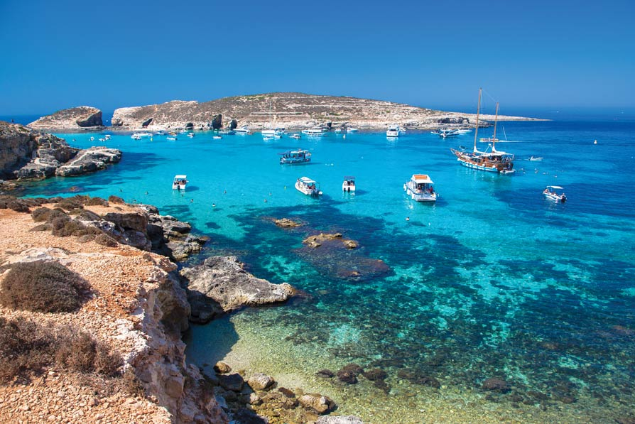 The waters of small and peaceful Comino, an island in the Maltese archipelago, are famous for their turquoise shades.Jaroslav Moravcik / Shutterstock.com