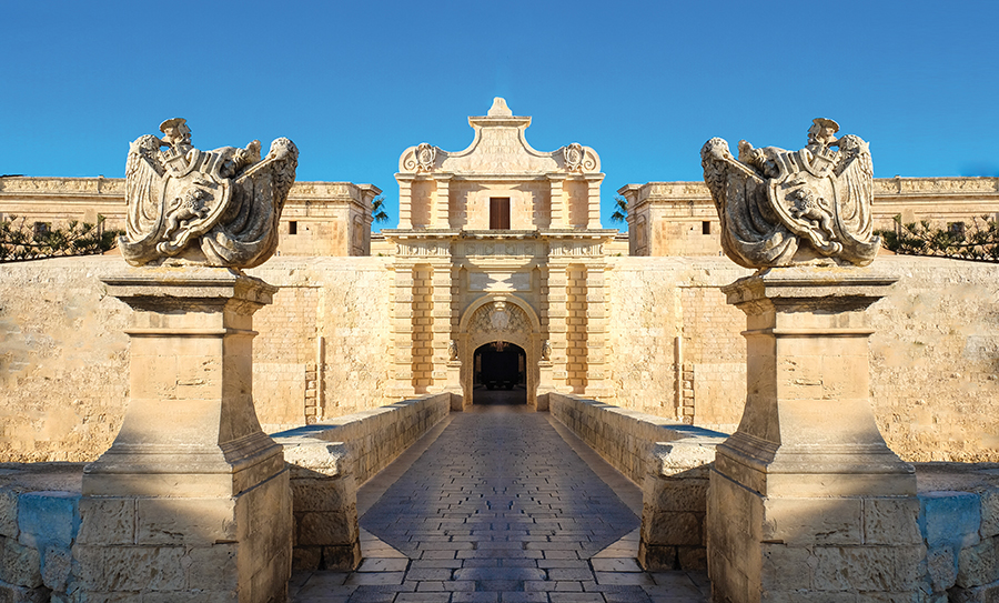 Mdina's city gate is the entrance to a perfectly preserved medieval city.Calin Stan / Shutterstock.