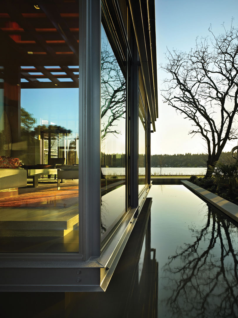 From the exterior, the same interior view, seeing out beyond the reflecting pool to Lake Washington.