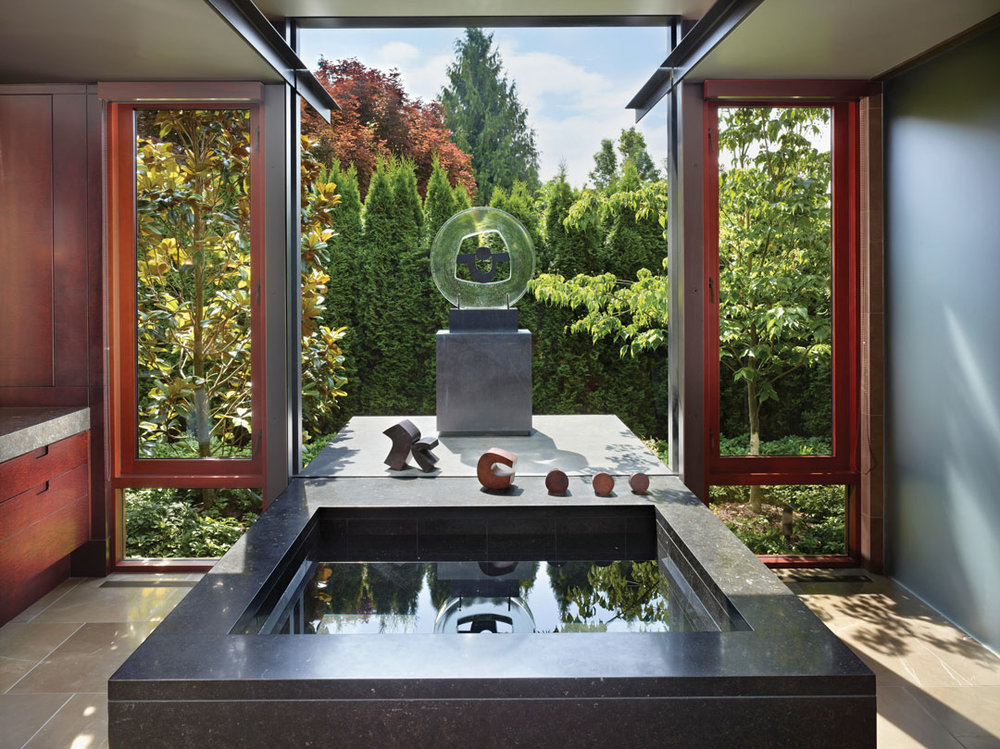 The homeowner's art collection extends outside to a sculptural work by Julie Speidel, reflecting and refracting the northwest Washington state landscape identity.