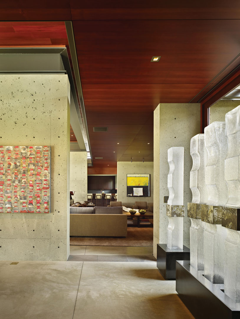 Interior glass sculptures by Joe McDonnell and original wall art by Catherine Eaton Skinner complement the interior flow from hall to living area.