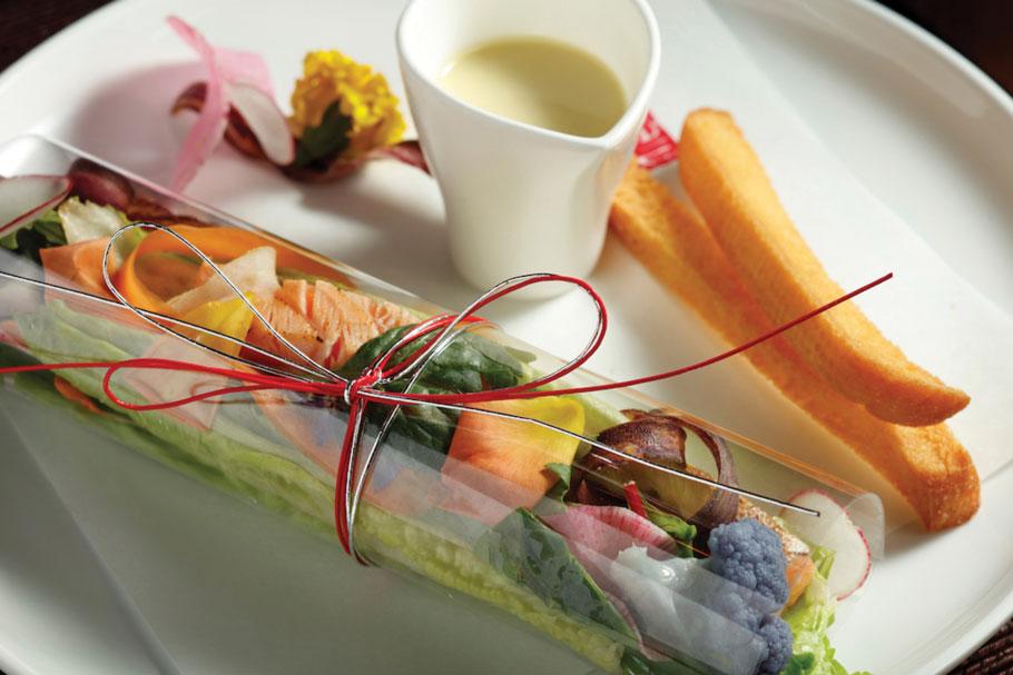 For the Mizuhiki Caesar Salad, crisp romaine lettuce with seared salmon and special caesar dressing.