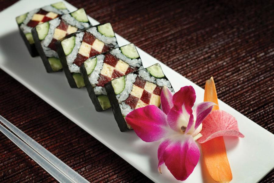 Morimoto Stained Glass Window Sushi Rolls combine tamago, tuna, cucumber, rice and nori into stunning pieces of Sushi art.