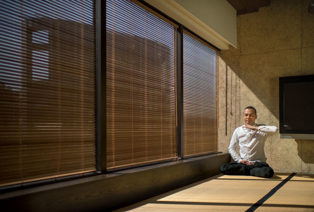 Shen believes meditation has been one of his keys to success, helping him cope with daily stress. Here he is doing the fifth meditation exercise of Falun Dafa.